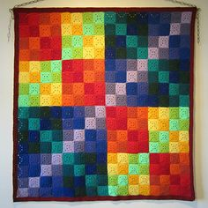 Knit or crochet afghan or wall-hanging with variations for a cushion or baby blanket.