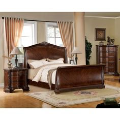 A sleigh style bed is the center of attraction in this Baroque style bedroom set. Intricate wooden carvings embellish the three piece collection.