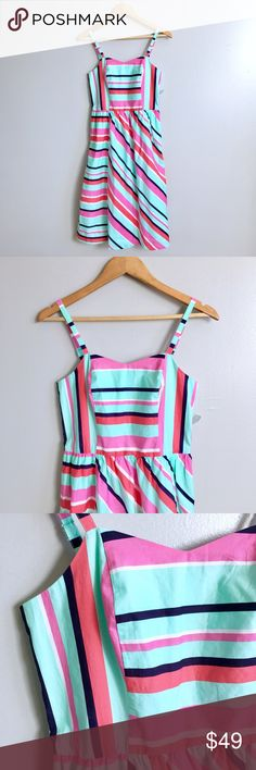 Candy Striped Dress Doesn't this dress make you so happy! Its fun, vibrant and airy. This dress is in excellent condition! Lined. Flattering fit. Adjustable straps. It's the perfect summer dress. Anthropologie Dresses Midi