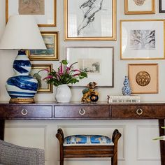 Define Arrange with Transitional Family Room and Artwork Blue Table Lamp Boston Cape Chair Rail Console Table Contemporary Gallery Wall Gold Frames Ikat Stool New England Tweed Armchair Vase Wainscoting Wall Art Casa Milano, Home Interior, Interior Design, Blue Table Lamp, Table Lamps, Grey Table, Black Table, Chinoiserie Chic, Blue Rooms