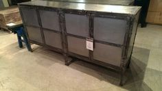 """Another fresh arrival. This large ultra industrial buffet is made from galvanized steel and iron. It has two large cabinets and measures 34"""" H"""", 65"""" W, 16"""" D-$1095"""
