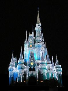 Walt Disney World Magic Kingdom Castle In Frosty Light Blue. This Frosty icicle look is only used by Disney during the winter holiday season.    I hope you enjoy these moments in time that have been captured.     