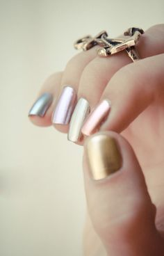 You won't be able to stop staring at these cool metallic nail polishes.