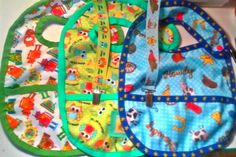 Waterproof Babyville Fabric Bibs With Pockets & Pacifier Clips