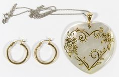 Lot 239: 14k Gold Jewelry Assortment; Four items including a pair of pierced hoop earrings, white gold necklace and mother of pearl heart pendant with gold pendant bail