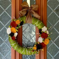 DIY fall wreath--yarn and felt flower wreath from Lauren's Creative blog