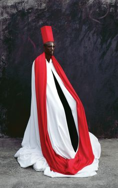 """Maïmouna Guerresi's Mystical Portraiture - The New Yorker """"The bodies of the people Maïmouna Guerresi photographs—usually friends and family, shot against a wall outside her house in Dakar, Senegal—seem to extend beyond their physical boundaries. Her subjects are shot in costumes that Guerresi constructs herself, often using textiles collected from her travels in Africa and Asia."""""""