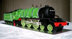 A 2ft long madeira cake in the shape of a famous steam train: The Flying Scotsman (A3 pacific steam locomotive for you train buffs!)