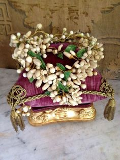 "Orange blossom wreath on a fancy cushion.  This was probably intended for a ""Globe de Mariee"" under glass."