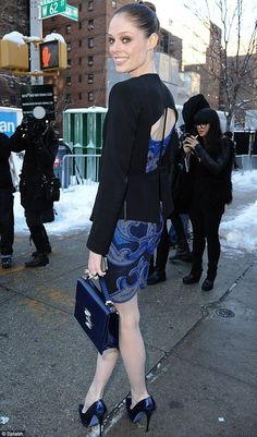 Coco Rocha bonkers I say in a blue cutout dress. Freezing but stunning #NYFW