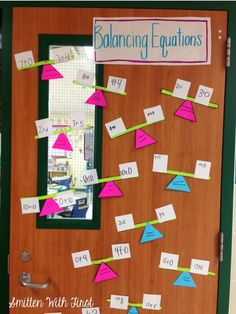 Balancing numbers door decoration idea to illustrate fact families. Great use of balance scale,too, to illustrate what the equal sign means.