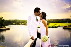 Gorgeous kiss as husband and wife among the setting summer sun at Avery Ranch!
