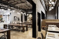 In the coffee shop, a geometric chandelier by Gabriel Scott hangs above custom-made leather banquettes.