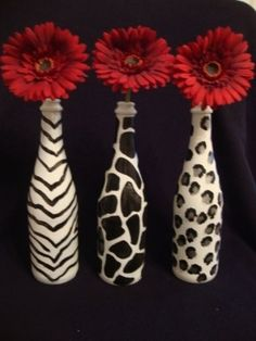 wine bottle craft ideas: not necessarily the animal print but solid colors with the gerber  daisies.