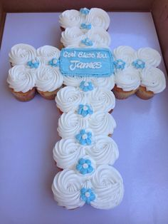 Photo of Westchester Bakery - Los Angeles, CA, United States. Vanilla cupcakes with buttercream frosting in a cross design for a baptism party