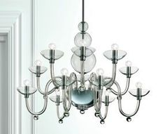 """DANIELI L12 SUSPENSION - <p style=""""text-align: justify;""""> This classic chandelier is an example of true craftmanship. Intricate yet sleek glasswork comprises the unique frame of the Danieli chandelier from the central metal and hand made glass bowl, cleanly curving arms culminate bowl-shaped light holders. Available in crystal glass with polished chrome structure. Companion wall sconce as well as a smaller size chandelier also available.</p>"""