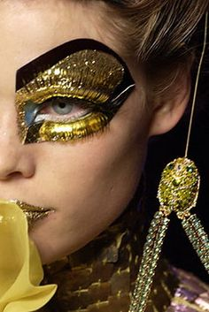 Dior, Spring 2004 Couture, eye make up  that would make Cleopatra jealous..