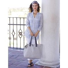 """Versatility and fashion sense come together in our newest Bateau Grey Stripe Reversible Tote.  Measuring 15"""" tall x 22"""" wide x 5.75"""" deep, it is made of 100% cotton canvas inside and out which is naturally strong and durable.  With its ample size, it will comfortably hold all your purse essentials as well as a change of clothes, a towel and more.  Fashion wise, there are options!  Choose either go-with-everything grey stripes on a white background, or white sailing boats on a ..."""