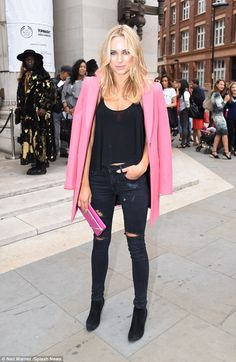 Pretty in pink: Kimberley Garner added a splash of colour to London Fashion Week on Saturd...