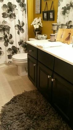 Bathroom Yellow And Gray black and yellow bathroom. the blak will tone done the ridic