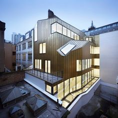 Shoreditch office by Piercy & Company has a restored facade and a golden behind.