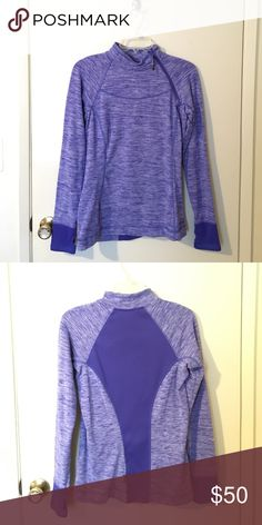 Purple running sweater Worn it a few times, too tight on me. Has a zipper on top right corner and the sleeves have holes for the thumb to come through. Warm and soft material inside. Eddie Bauer Sweaters Crew & Scoop Necks