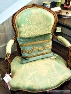 Antique Louis arm chair dressed in resplendent aqua-hued upholstery.   The Decorating Diva, LLC