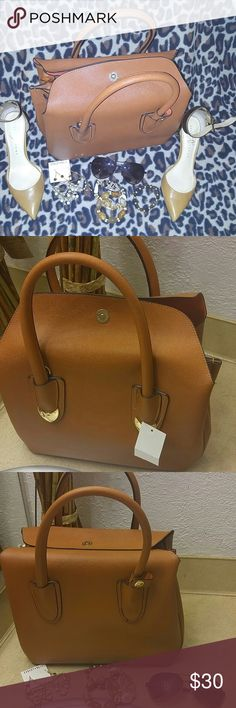 New CLASSY PURSE WITH TAG Fab color...very classy..interior is full of life ..perfect addition to that wardrobe. Comes with a shoulder strap and a dustbag Bags Hobos