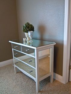 Mirrored Dresser DIY -   Spray paint metallic ,Mirrored furniture is so trendy right now, and this great post shows you how to create this look yourself! With this tutorial you'll create a stylish mirrored dresser for much less than just going out and buying one. A great piece for your master bedroom!