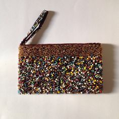 Beaded Multi-Color Purse Clutch Wallet Wristlet Like new condition. Gorgeous. Can hold an iPhone and little other things. Could serve as a clutch. Very unique color. Width: 8 inches. Length: 4.5 inches Bags Wallets