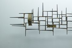 Google Image Result for http://www.modern50.com/files/gimgs/2936_mid-century-modern-brass-steel-wall-art2.jpg