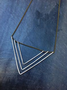 Sterling Silver Deco Geometric Triangle Necklace -by Loop Jewelry- Hammered Silver-Geometric Silver Necklace-Triangle necklace-Deco-portland by LoopHandmadeJewelry on Etsy https://www.etsy.com/listing/165723377/sterling-silver-deco-geometric-triangle