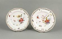Zwei Teller, KPM Berlin, um 1820, 1. W., Form Reliefzierat mit durchbrochener Kante, besetzt mit Vergissmeinnichtblüten, im Spiegel polychrome Blumen- und Insektenmalerei, ziervergoldet, D. 24 cm