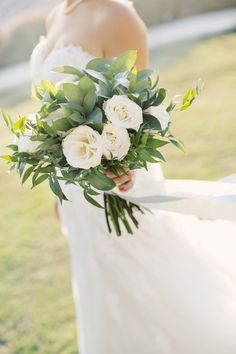Bride's Beautiful Bouquet Of White Garden Roses + Green Foliage Hand Tied With A White Silk Ribbon