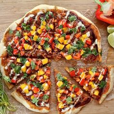 """Vegan BBQ """"pulled pork"""" pizza with mango salsa and cashew creme. You'll never guess what the """"pulled pork"""" actually is!"""