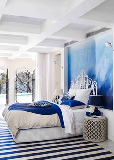 For bedroom bliss, try a soothing blend of fresh white and sapphire blue linen