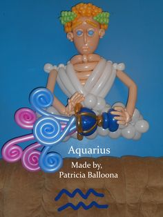 Balloon Aquarius  Zodiac Sign: Ganymede, tired of being Zeus's cupbearer on Mount Olympus, pouring out Zeus's cup onto the Earth creating a flood. Made by Patricia Balloona,  https://patriciaballoona.wordpress.com/2015/02/18/450th-balloon-sculpture-aquarius-zodiac-sign/