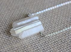 This raw crystal necklace is a versatile piece that can compliment a variety of styles. The handmade necklace features 3 beautiful rose luster quartz crystal stones carefully pieced together in order to prevent gaps or visible wire.