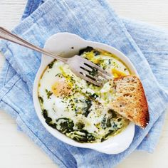 Baked eggs with fresh herbs, ricotta and lemon zest for a simple, but satisfying meal.