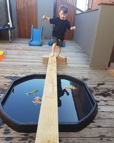Putting a balance beam over our tuff tray was such a simple buy amazing play experience for Mr 3 and Miss . Usually they climb,… Sensory Games, Sensory Play, Sensory Table, Outdoor Learning, Home Learning, Toddler Fun, Toddler Preschool, Work Activities, Toddler Activities