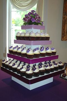 Wedding cupcakes by Cupcake Chic by cupcakechicutah, via Flickr    Square cupcake tower! I would do a plum satin ribbon on all the levels though.