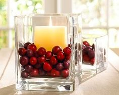 Christmas centerpiece with cranberries, candles and simple glass holders
