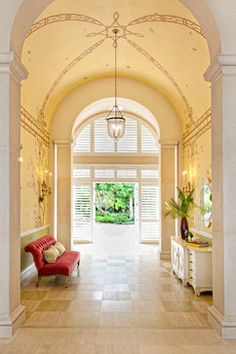 Casual Palm Beach---A low-slung, luxurious settee and sideboard keep the focus on the spectacular barrel ceiling and decorative painting, Which are the stars of the space.
