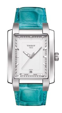 The new Tissot TXL Ladies' watches marry a passion for fashion with classical watch design. Ladies have always loved squared timepieces and these new models add color to this proven harmonious formula. Elegant lines and dials kept in place by stunning embossed leather straps in turquoise, red, black, green or pearly white, or metal -stainless steel bracelets. Shown here with a marvelous turquoise leather strap and silver dial. These watches promise to remain as individual as their owners.