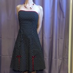 Black and white polka dot dress with red detail Strapless black dress with white polka dots. Red ribbon detail with black floral lace fabric underneath. Size 5 junior's. Fits like a 0-2 women's. Hem falls at the knee on me. A. Byer Dresses Strapless
