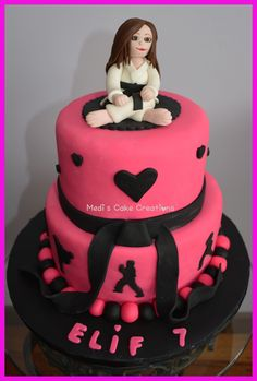 My Taekwondo cake creation with an edible black belt girl topper... This is from my facebook page... Medi's Cake Creations