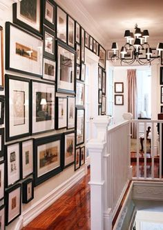 Floor to Ceiling Picture Frames.  I want my hallway to look like THIS!