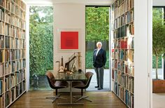 Each square unit has narrowly spaced dividers to stop books sliding down when you take one out. Shelves in US architect Hugh Newell Jacobsen's home.