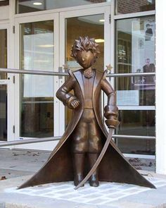 """""""One sees clearly with the heart; anything essential is invisible to the eyes."""" The Little Prince statue, unveiled September 16, 2006 in the courtyard of the Northport Public Library, commemorates the internationally loved classic by Antoine de Saint-Exupéry"""