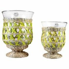 "Set of 2 glass candleholders with hand-woven seagrass sleeves.    Product: Small and large candleholderConstruction Material: Glass and seagrassColor: GreenFeatures: Hand-woven sleevesAccommodates: (1) Candle - not includedDimensions: Small: 6"" H x 4.6"" DiameterLarge: 7.6"" H x 5.8"" Diameter"